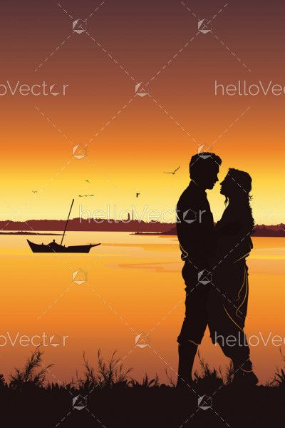 Silhouette of young romantic couple on sunset background